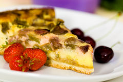 Fresh rhubarb cake with strawberry and cherry Royalty Free Stock Image