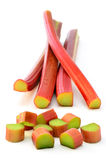 Fresh rhubarb. Fresh picked organic ruby red rhubarb on white background in vertical format Royalty Free Stock Photos