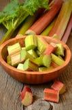Fresh rhubarb on wooden garden table Stock Photo