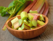Fresh rhubarb on wooden garden table Stock Photography
