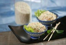 Fresh rice salad. On blue background royalty free stock image
