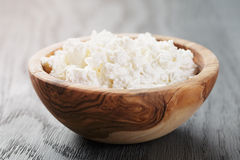 Fresh ricotta in olive wood bowl Royalty Free Stock Photography