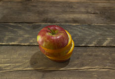 Fresh ripe apple and orange on a wooden table Royalty Free Stock Photos