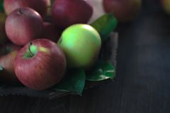 Fresh ripe apples on a wooden background. Autumn still life. Stock Image