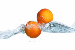 Fresh ripe apricot  dropped into water splash Royalty Free Stock Image
