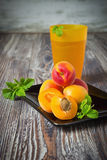 Fresh ripe apricots. On a black plate and apricot juice.copy space background Stock Photos