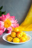 Fresh and ripe apricots on grey background. Season berries, summer food. Some fresh and ripe apricots on the table colored in grey, decorated with napkins Royalty Free Stock Images