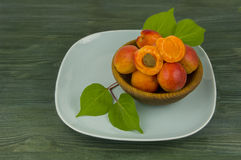 Fresh ripe apricots on a turquoise plate.  Royalty Free Stock Image