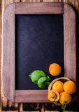 Fresh ripe apricots in wood bowl on vintage slate chalk board background. Selective focus. Background with place for some text. To Stock Photo