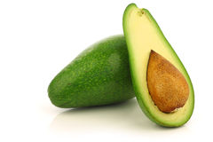 Fresh and ripe avocado and a cut one Stock Image