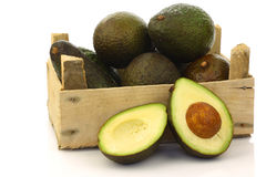 Fresh and ripe avocado's and a cut one in a box Royalty Free Stock Image