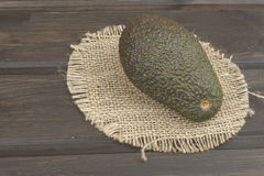 Fresh ripe avocado on a wooden background. Food background with fresh organic avocado. Royalty Free Stock Image