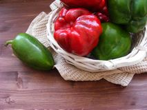 Mix fresh ripe bell peppers on brown table stock images