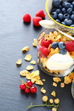 Fresh ripe berries and granola in a glass Royalty Free Stock Image