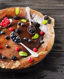 Fresh ripe berries raspberries blackberries and blueberries, top view. Fresh ripe berries raspberries blackberries and blueberries on a brown wooden plate with a Royalty Free Stock Photos