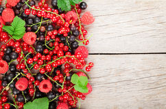 Fresh ripe berries on wooden table Royalty Free Stock Image