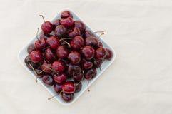 Fresh ripe black cherries Stock Image