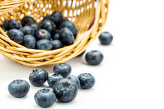 Fresh ripe blueberries in wicker basket Royalty Free Stock Photos
