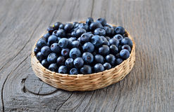 Fresh ripe blueberries on wooden table. Close up Royalty Free Stock Image
