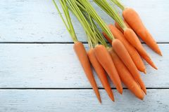 Ripe carrots. Fresh and ripe carrots on blue wooden table Stock Image