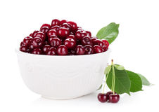 Fresh ripe cherries in bowl Stock Images