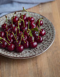 Fresh and ripe cherries from the garden. Season berries, summer food. Some fresh and juicy cherries on the table,decorated with gauze napkin Royalty Free Stock Images