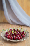 Fresh and ripe cherries from the garden. Season berries, summer food. Some fresh and juicy cherries on the table,decorated with gauze napkin Royalty Free Stock Photography
