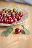 Fresh and ripe cherries from the garden. Season berries, summer food. Some fresh and juicy cherries on the table,decorated with gauze napkin Stock Photography