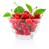 Fresh ripe cherries with leaves in glass bowl isolated on white royalty free stock photos