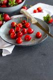 Fresh ripe cherries on a plate Royalty Free Stock Images