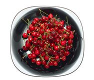 Fresh ripe cherry berry in black glass dish Stock Photos