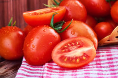 Fresh ripe cherry tomatoes. Close-up of fresh ripe cherry tomatoes on wooden background Royalty Free Stock Photos