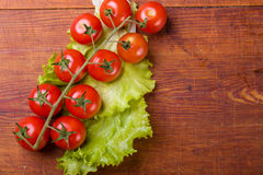 Fresh, ripe cherry tomatoes on an old wood Stock Photography