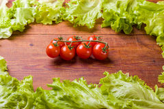 Fresh, ripe cherry tomatoes on an old wood Stock Image