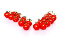 Fresh ripe cherry tomatoes on white background Royalty Free Stock Images