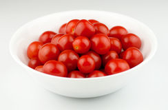 Fresh, ripe cherry tomatoes in a white bowl Royalty Free Stock Image