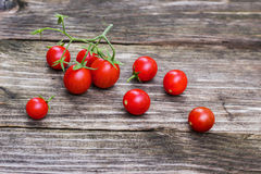 Fresh, ripe cherry tomatoes on wood board Stock Photography