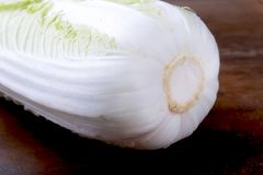 Fresh ripe Chinese cabbage on the cutting board. Ingredients for salad. Ready for cooking. Fresh ripe Chinese cabbage on the cutting board. Ingredients for Royalty Free Stock Photography