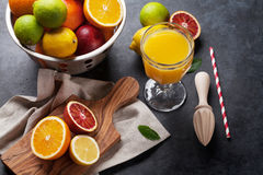 Fresh ripe citruses and juice. Lemons, limes and oranges Royalty Free Stock Photos