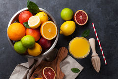 Fresh ripe citruses and juice. Lemons, limes and oranges Stock Photo