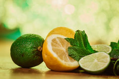 Fresh ripe citruses with mint on garden wood table Royalty Free Stock Image