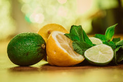 Fresh ripe citruses with mint on garden wood table Stock Photo