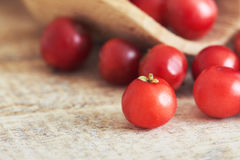 Fresh ripe cranberries. Closeup of fresh ripe cranberries on wooden background. Copy space Stock Photo