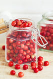 Fresh ripe cranberries. In glass jar on wooden background Royalty Free Stock Photography