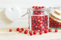 Fresh ripe cranberries. In glass jar. Copy space Stock Image