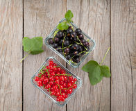 Fresh ripe currant berries on wooden table Royalty Free Stock Photo