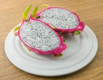 Fresh Ripe Dragon Fruit on A White Dish. Fresh Fruits, Ripe and Sweet Dragon Fruit or Pitaya on A Plate Stock Image