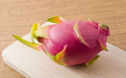Fresh Ripe Dragon Fruit on A Wooden Tray. Fresh Fruits, Ripe and Sweet Dragon Fruit or Pitaya on A Wooden Cutting Board Royalty Free Stock Photo