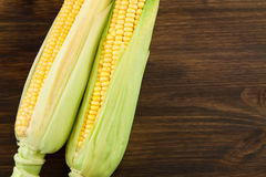 Fresh ripe ears of corn wooden background Stock Photo