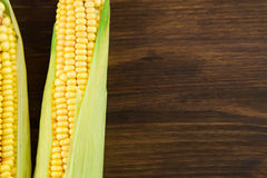Fresh ripe ears of corn on wooden background Stock Photo